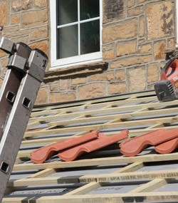 Roofer working up a ladder